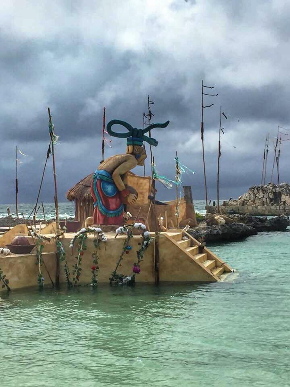 Godess Ix Chel statue at Xcaret ritual bay.