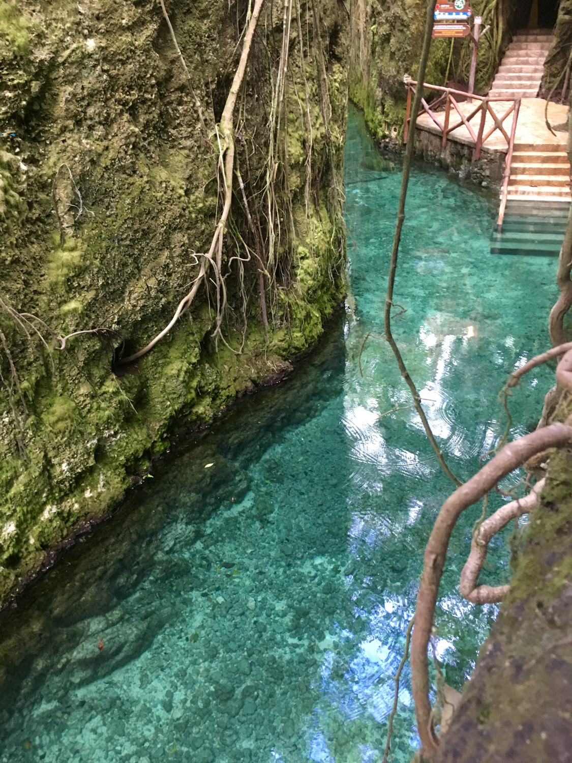 One of the three rivers for floating and a waterfall in the cave.