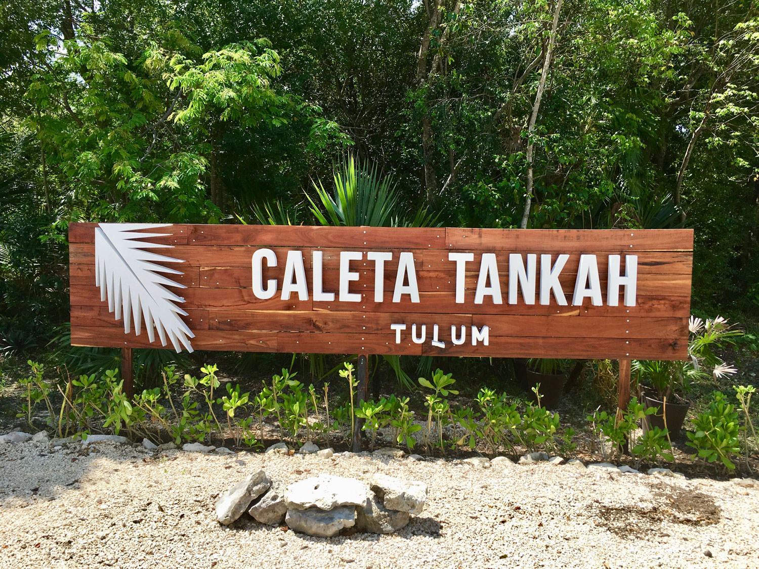 Turn in by this sign for Tankah Bay.
