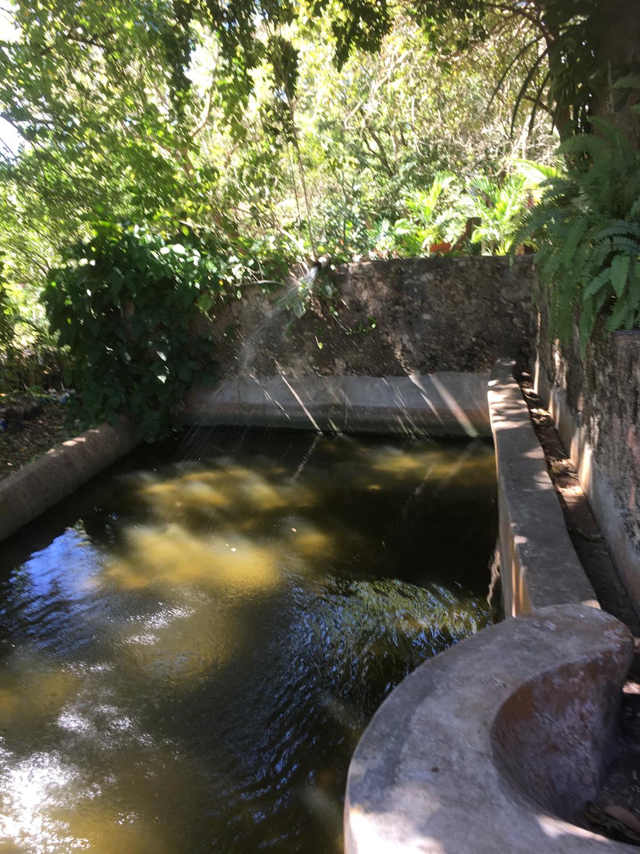 A colonial reservoir for garden irrigation.