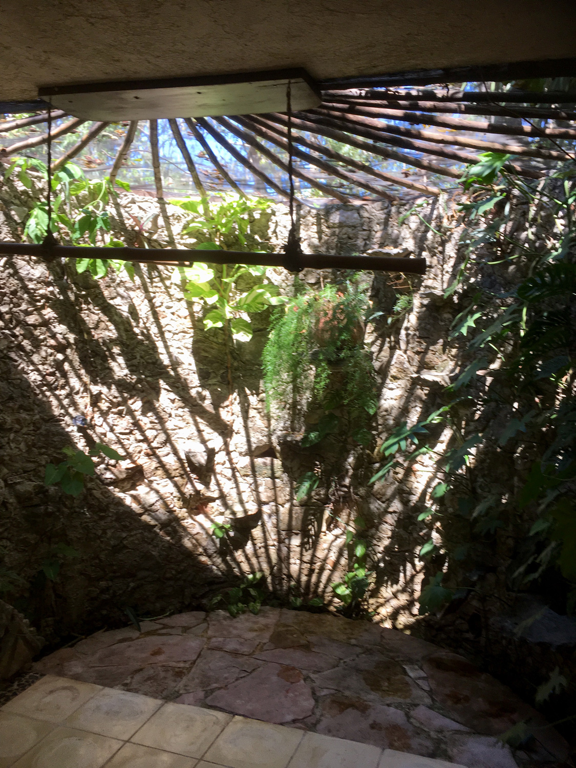 The rustic stone massage parlour connects with nature.