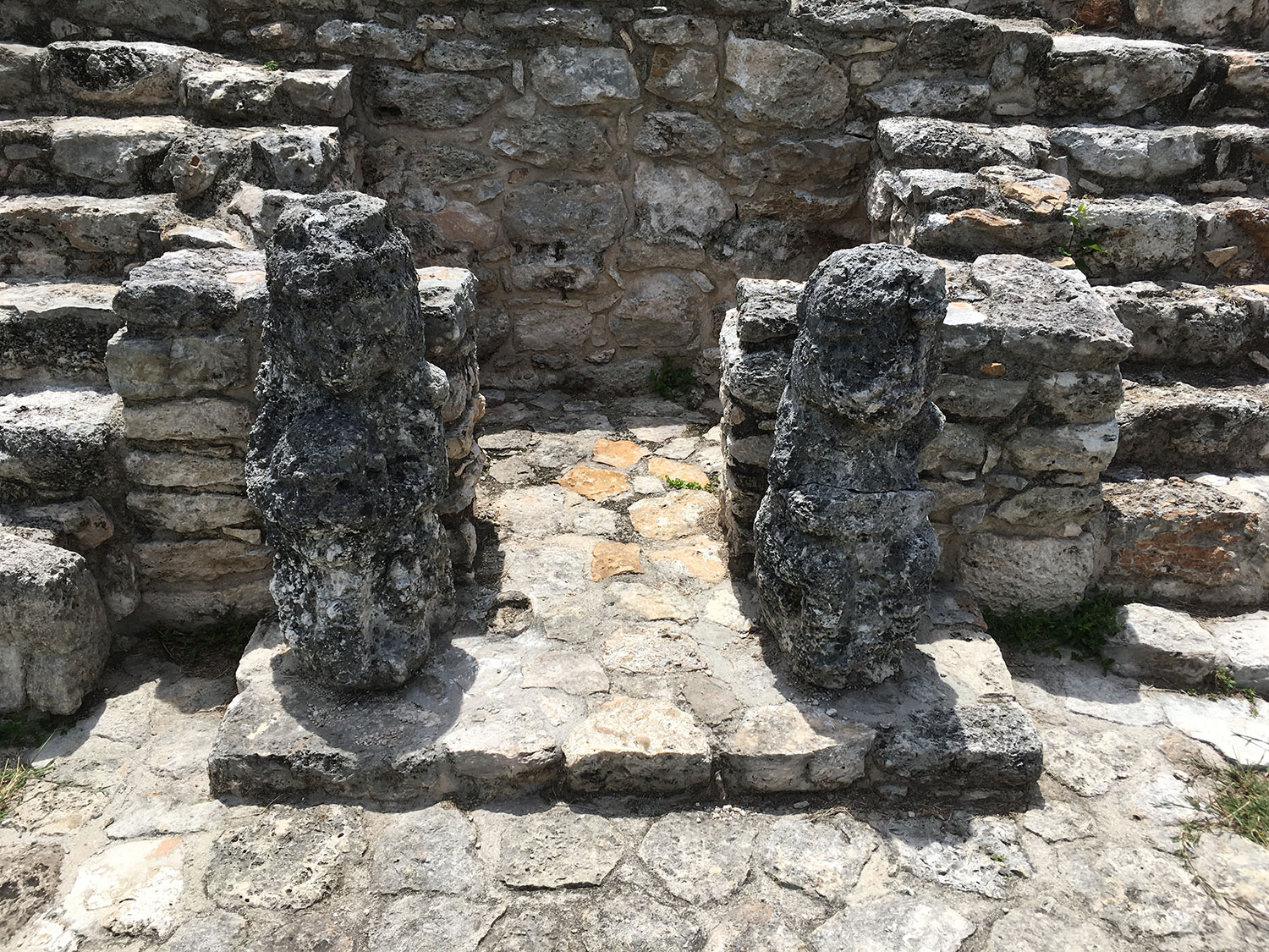Two eroded statues keep their secret.