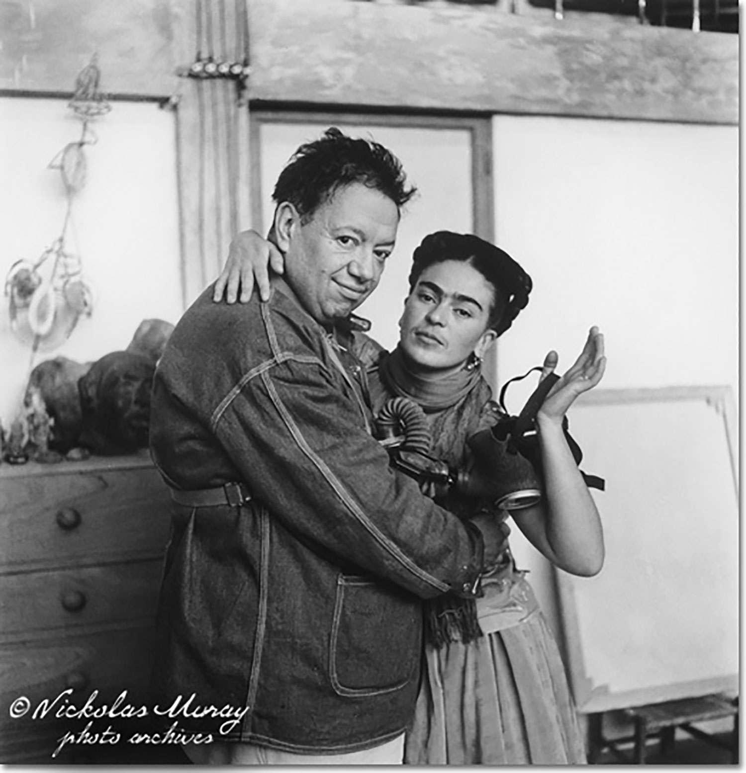Frida and Diego with Gas Mask. Apparently Diego wore it when he was painting:  Nickolasmuray.com .