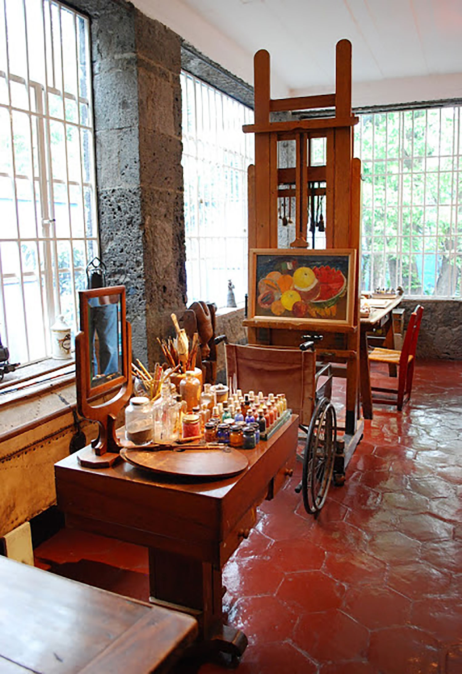 Frida's studio with her wheelchair.