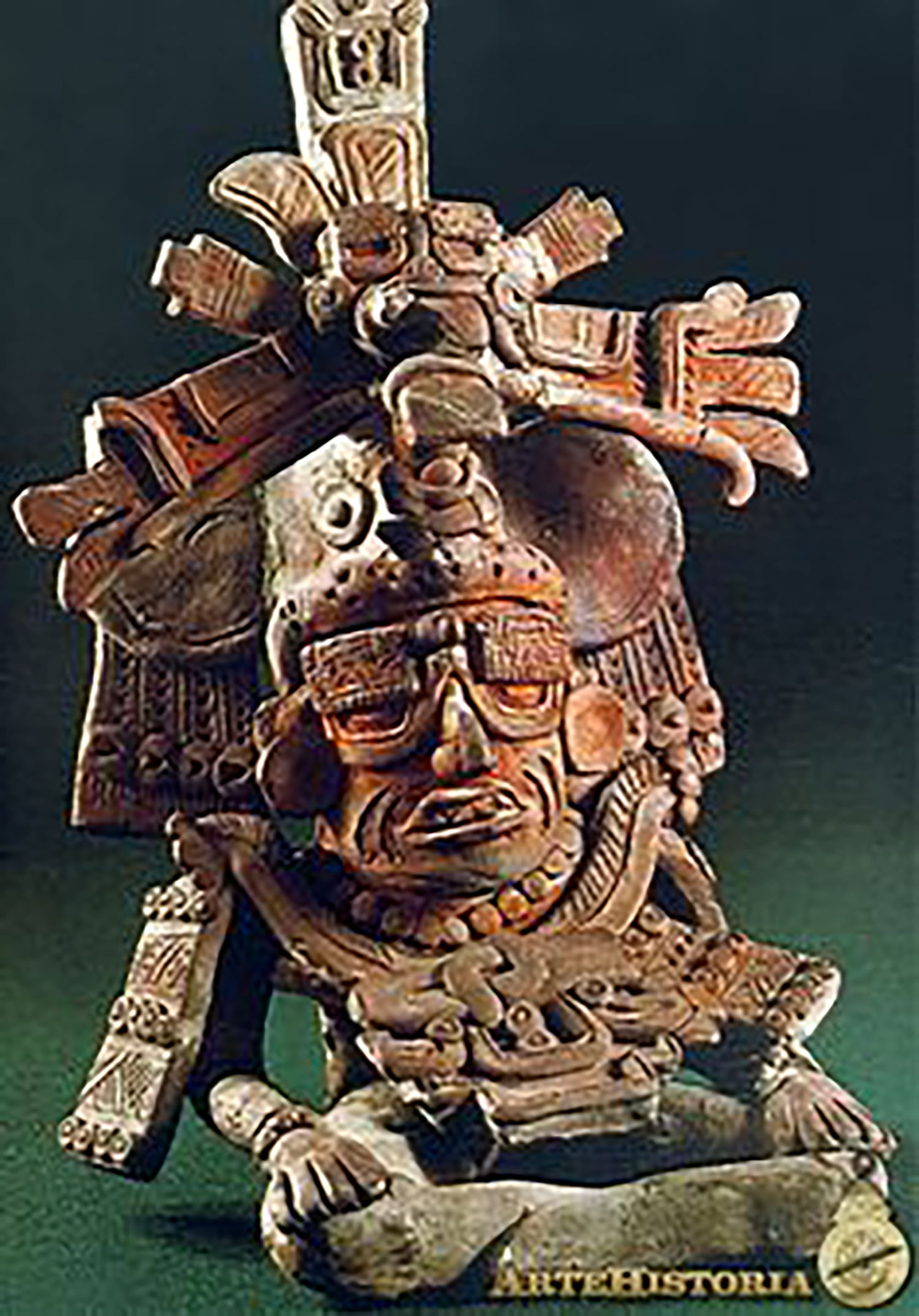 Zapotec god with goggles, Monte Albán, 400-600 AD:  pinterest.com .