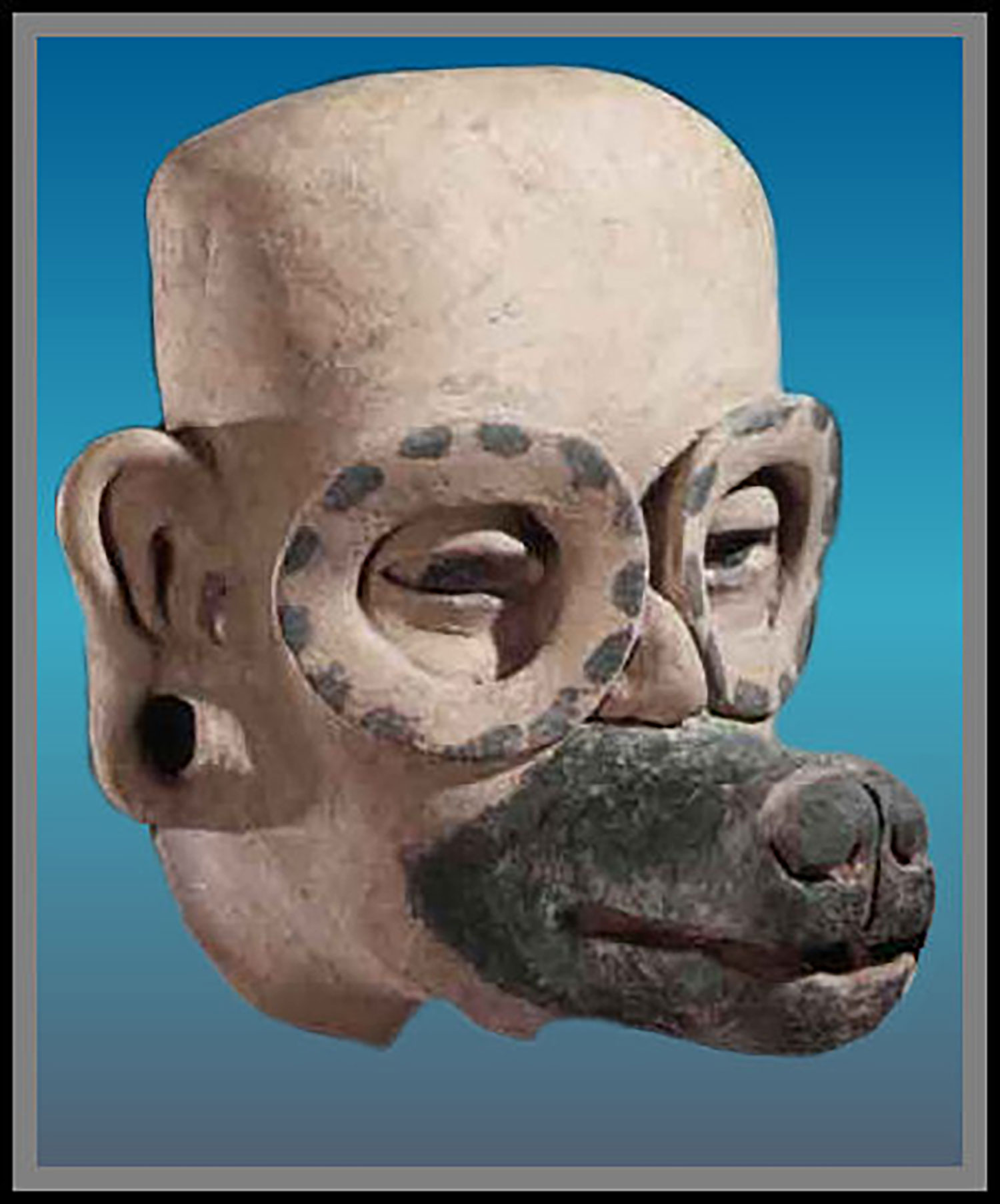 Humanoid dog with goggles (Photo by Justin Kerr):  mesoamericancalendarstudies.com .