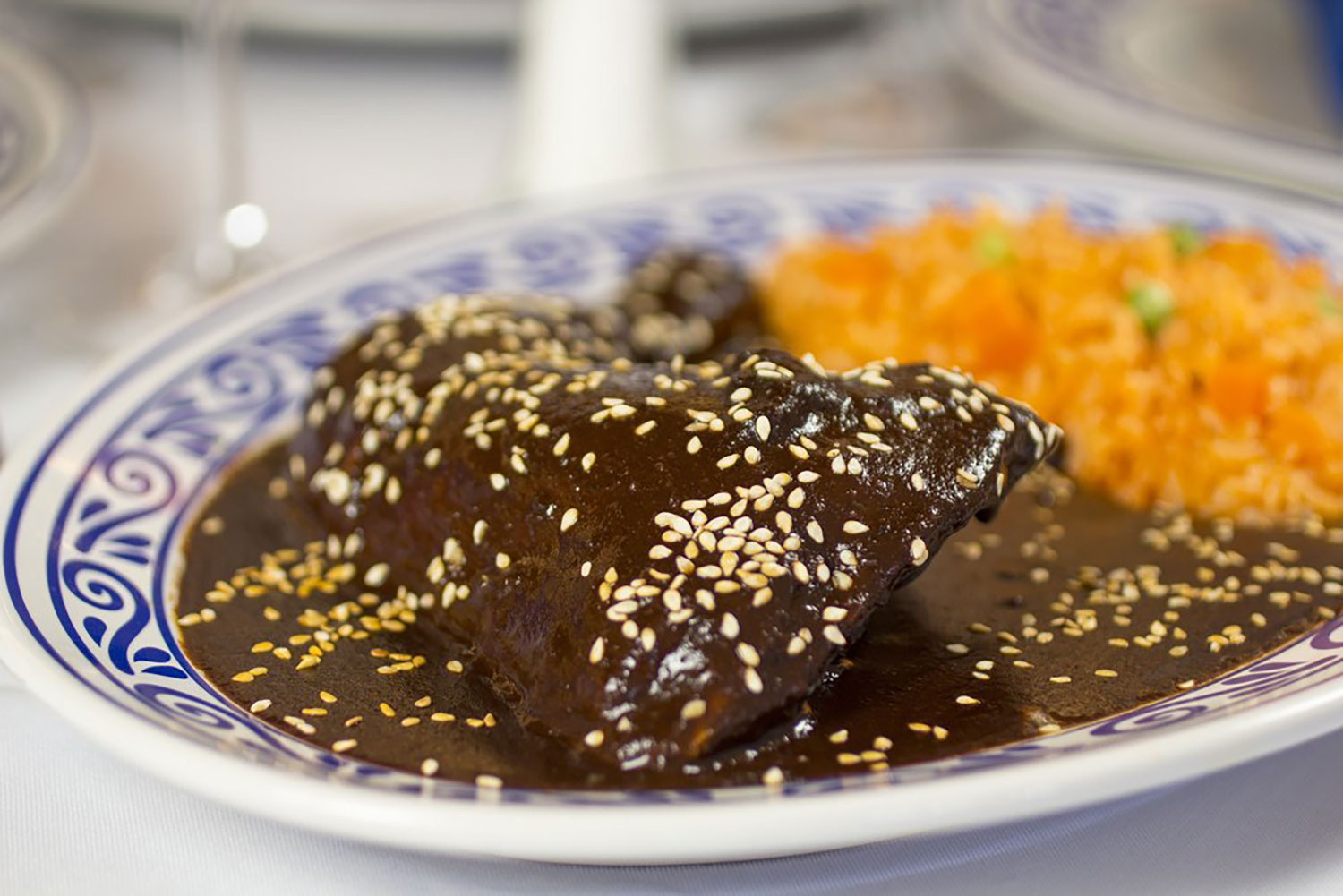 Chicken mole. Right: La Gruta. Credit: Flickr.