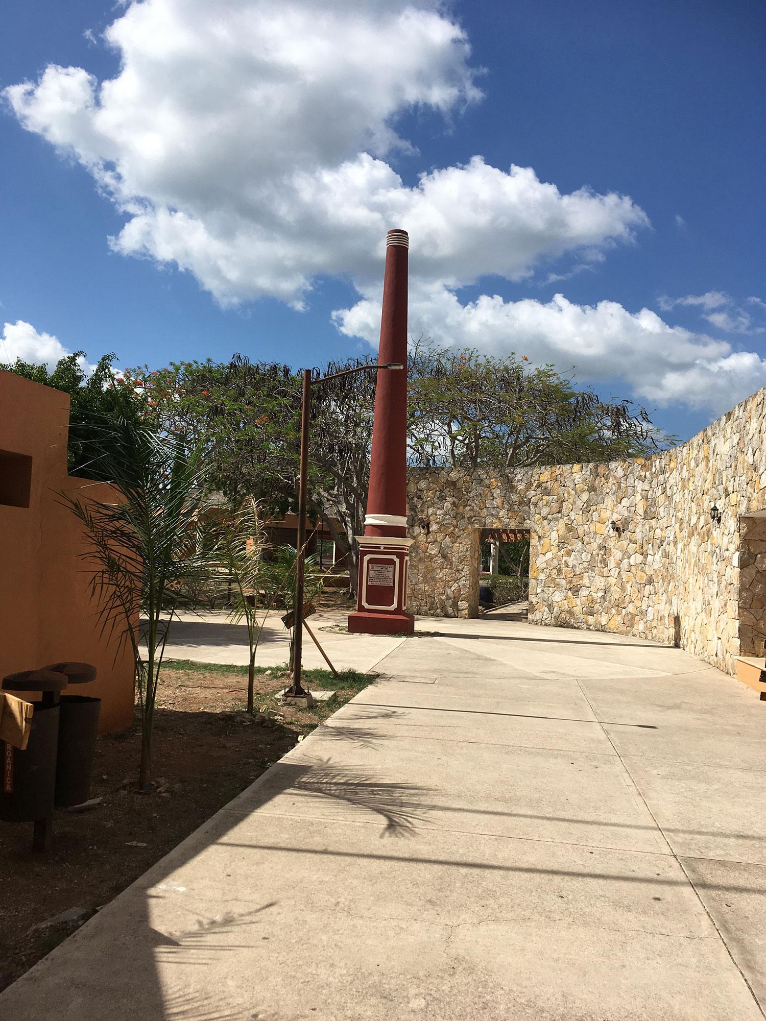 The hacienda chimney at the cenote Sambulá, a former hacienda land.