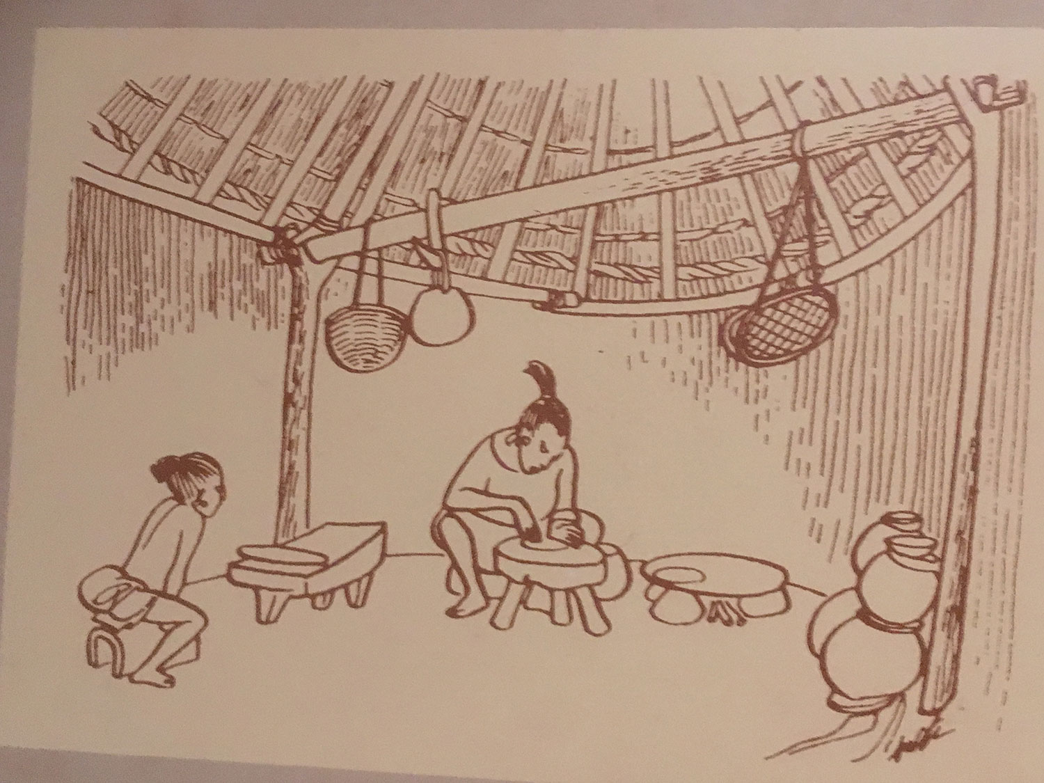 A household scene. Not different from today's dwellings in the jungle.