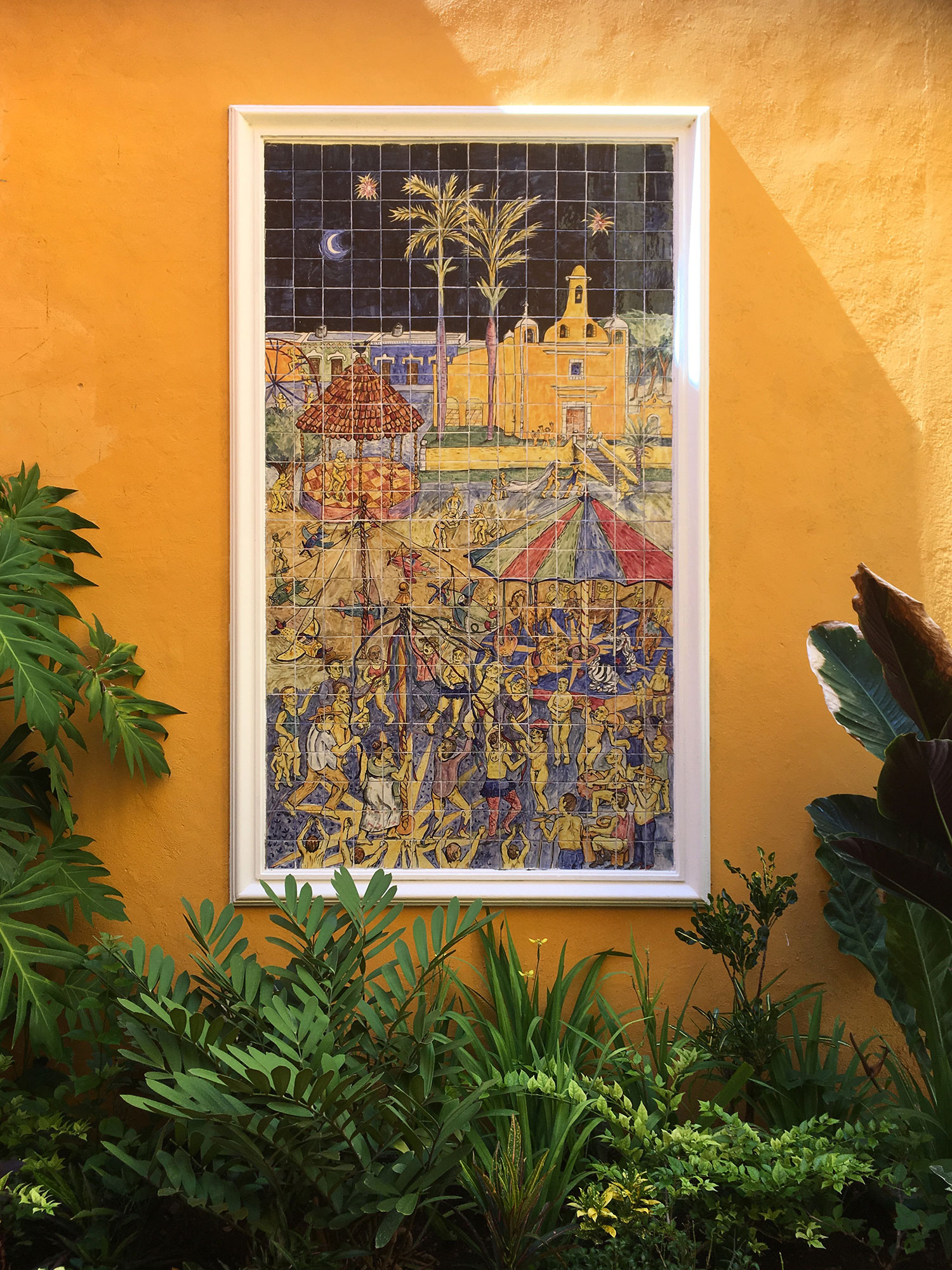 Tile murals by Daniel Rosel in the private garden of a guest's suite.
