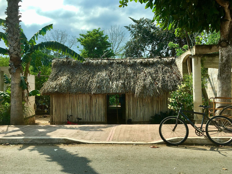 Maya wooden houses around the cenote.