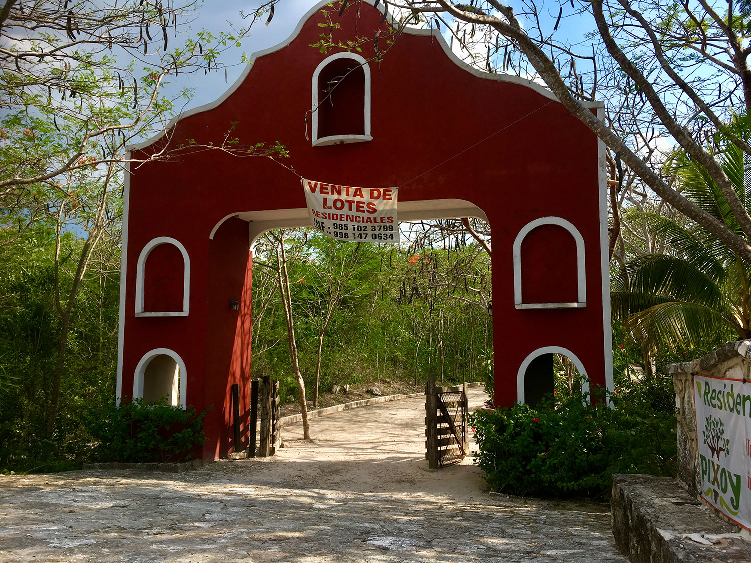 A typical arch entrance to the hacienda. Note the for sale sign.