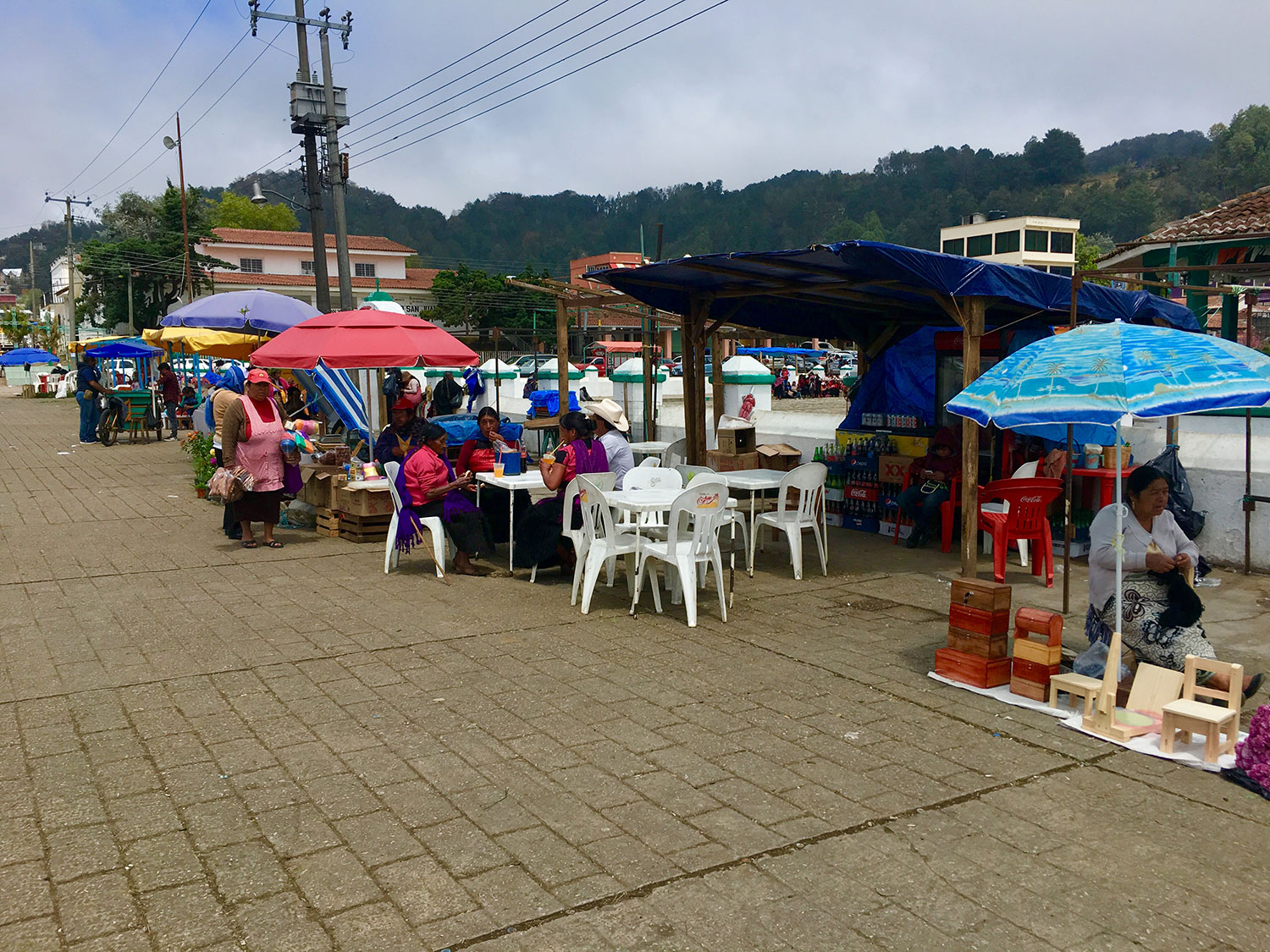 The market on the church plaza. Right: wool for sale.