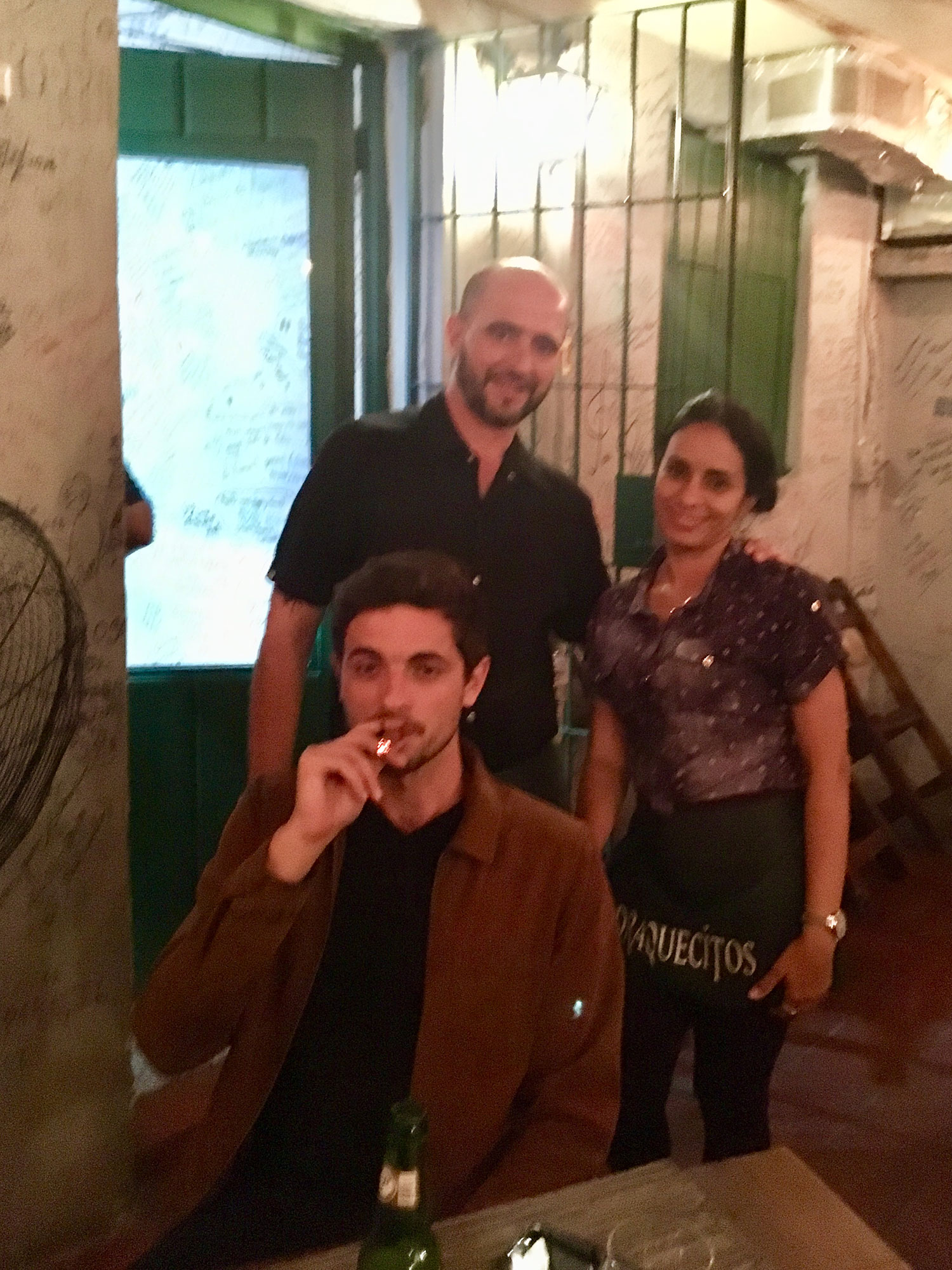 Rhodri smoking a cigar at Draquecitos. With Alexis and his partner.