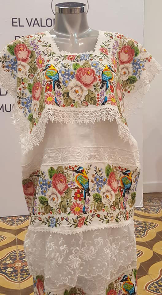 Huipil  from Yucatán (photo by my friend Janet Lowe). On the left:  huipils  from Chiapas. Each Maya region has different embroidery motifs.