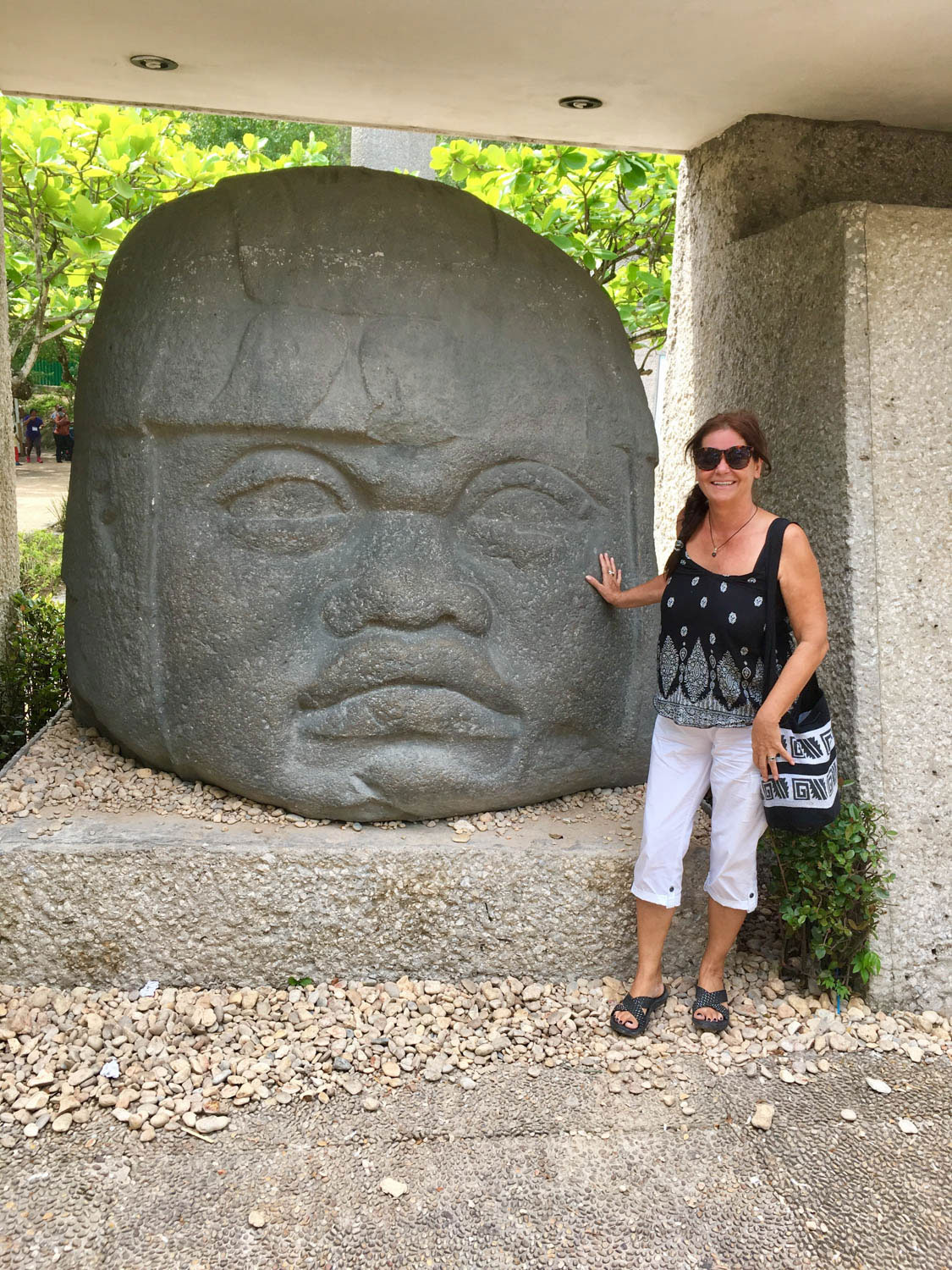 With an Olmec colossal head at La Venta Museum.