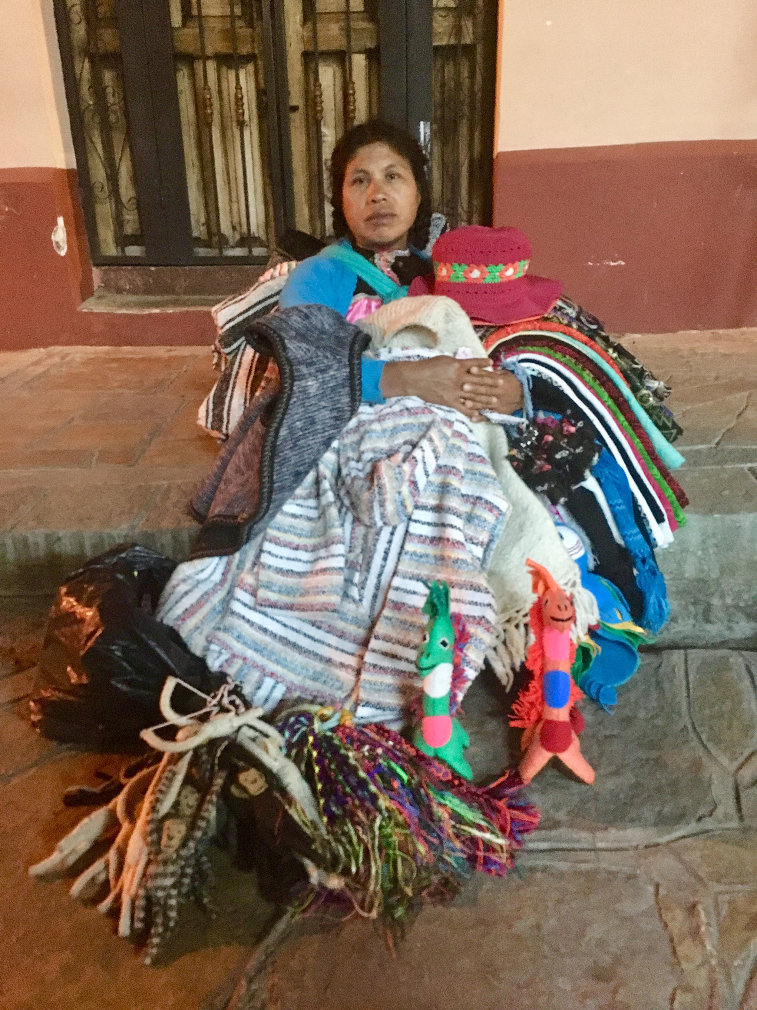 Tzotzil street vendor of textiles in San Cristóbal.