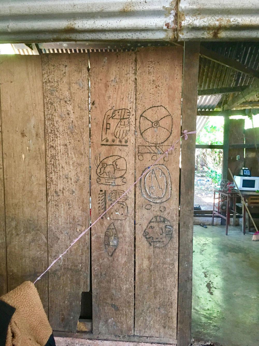 Maya hieroglyphs made by his daughter.
