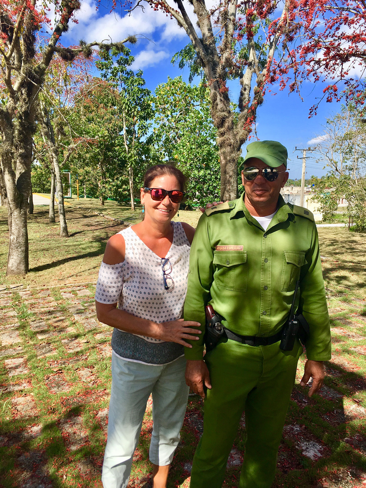 With a Cuban soldier, Under a Monkey Flower Tree.