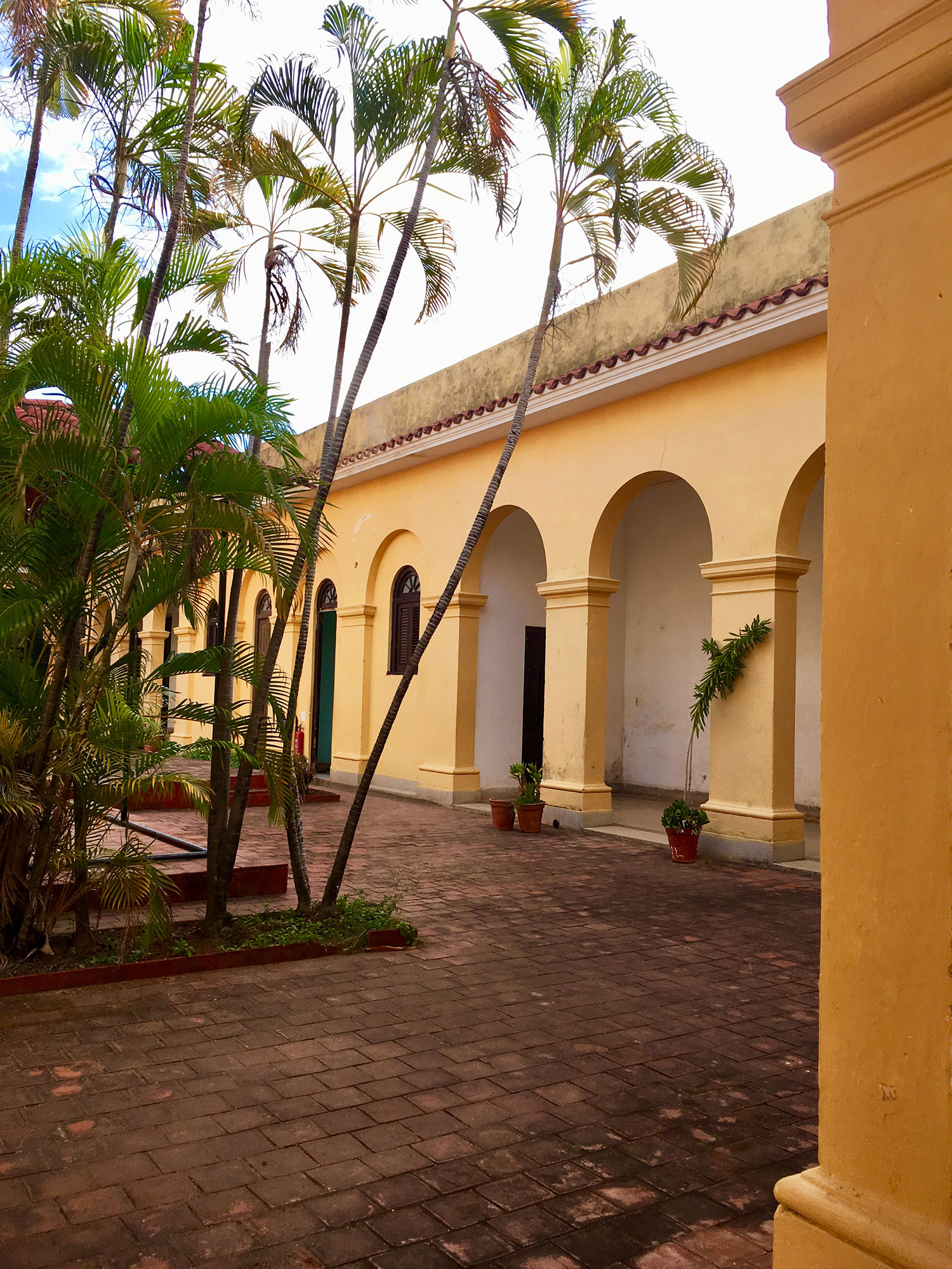 The arched corridors of the former convent.