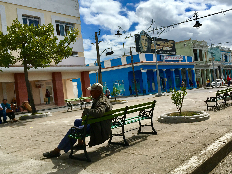 Che Guevara's large billboard on a building in Cienfuegos.