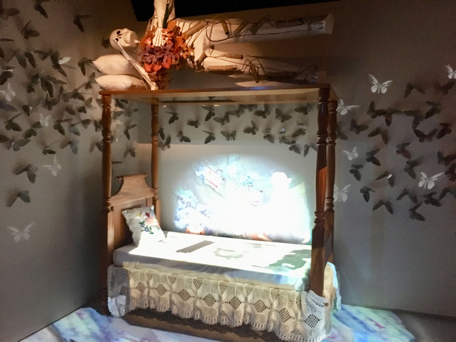 Frida's bed with the moving image and the butterflies.