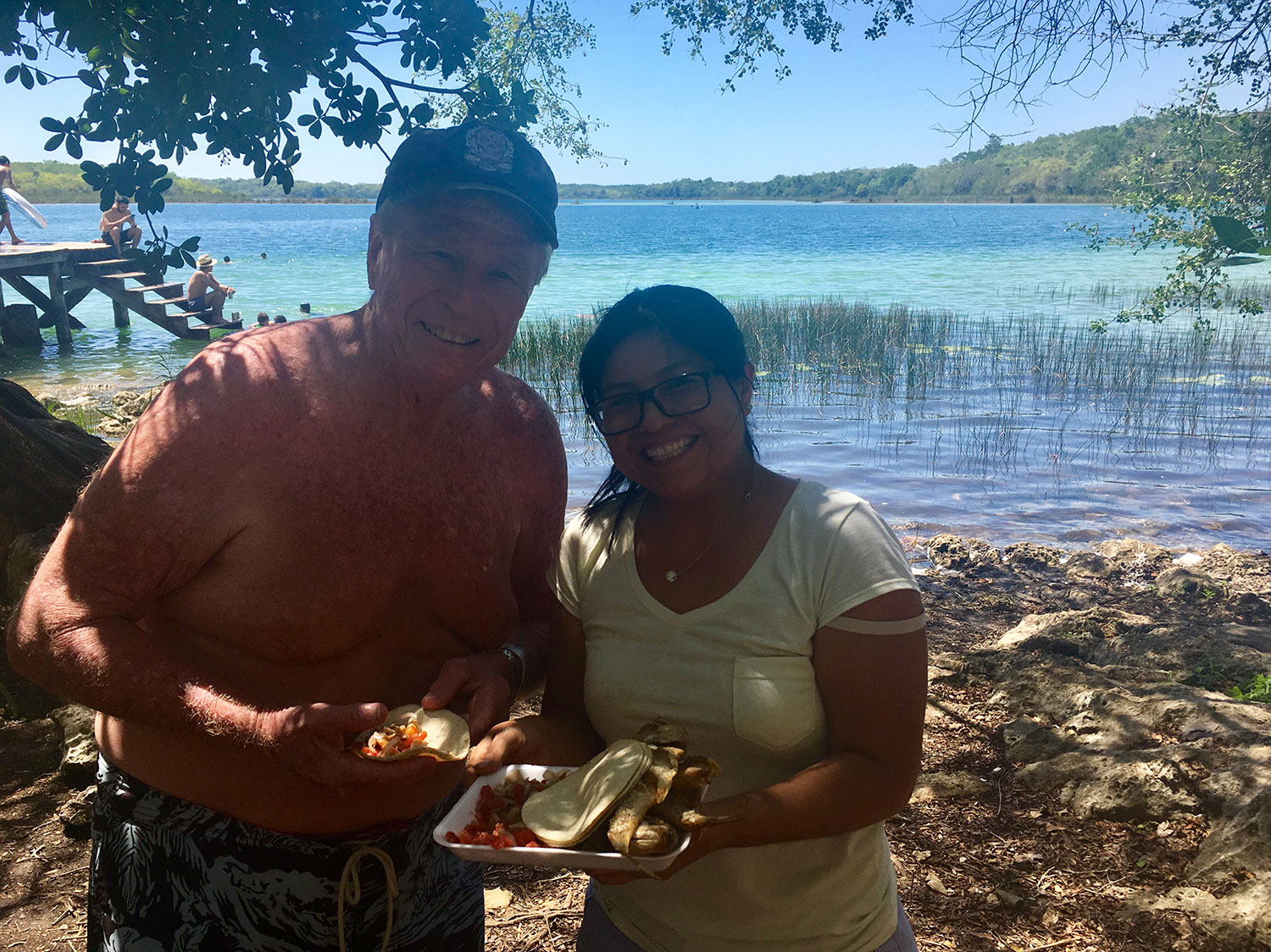 My friend Jim with a Maya lady who offered us fish to share.