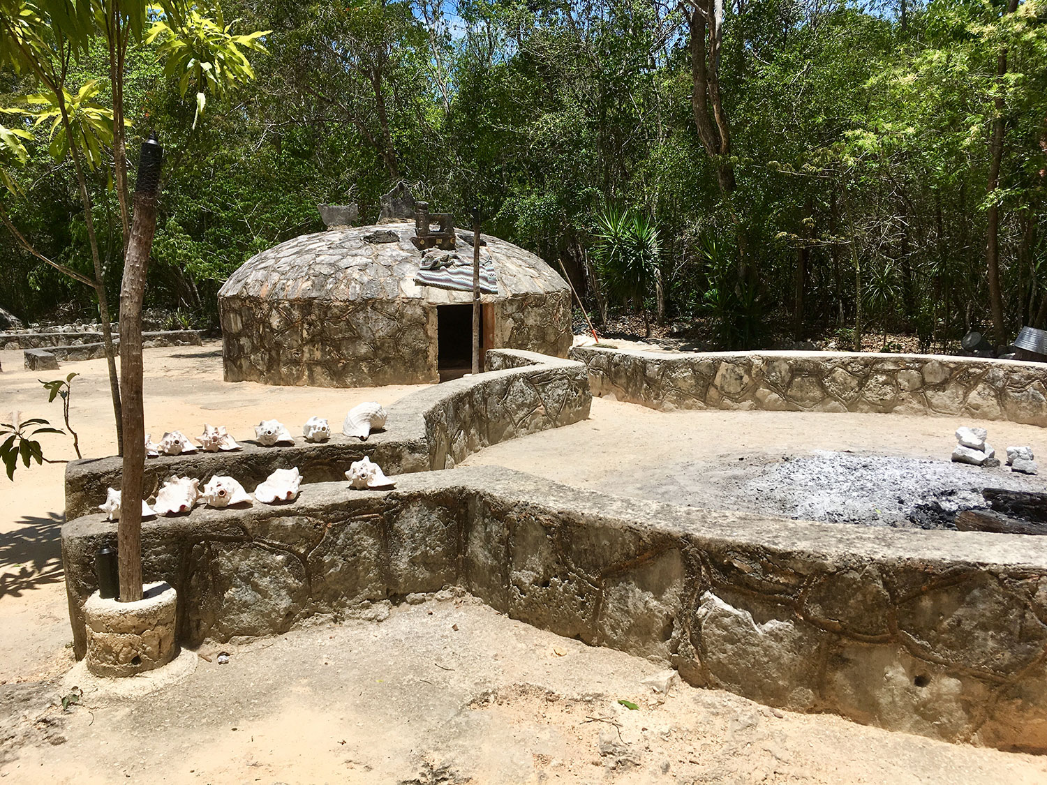 The temazcal 'igloo' and the round enclosure for the bonfire.