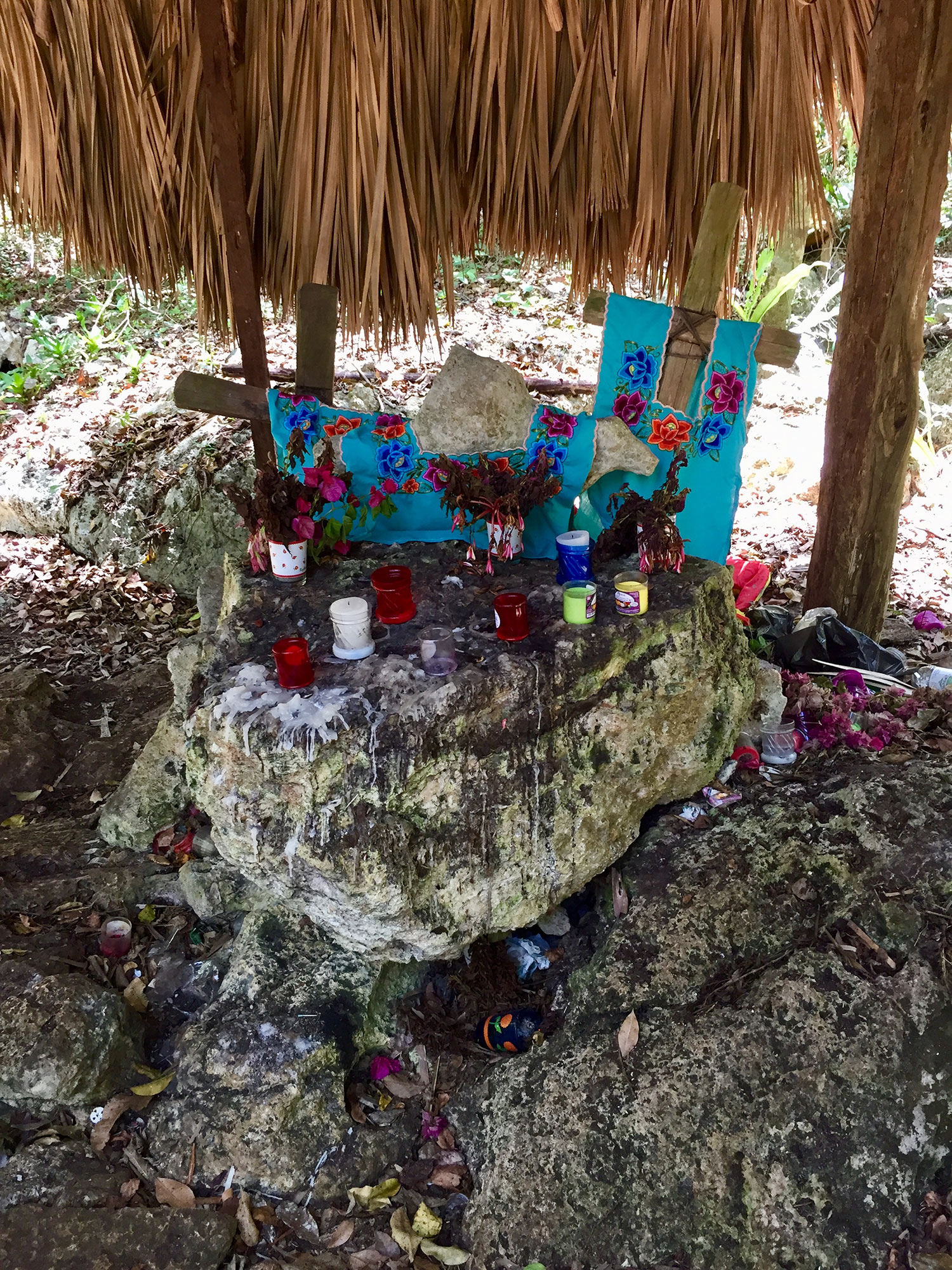 Crosses at Punta Laguna jungle, by the cenote, dressed in  sudario  cloth.