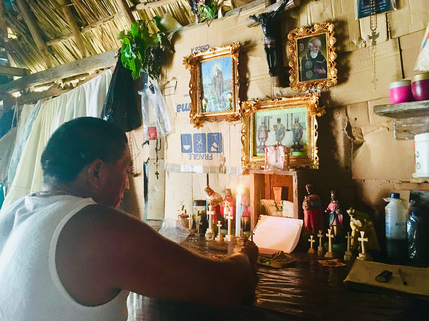 Zacarías the shaman in a ritual. Note the crosses in his shrine.