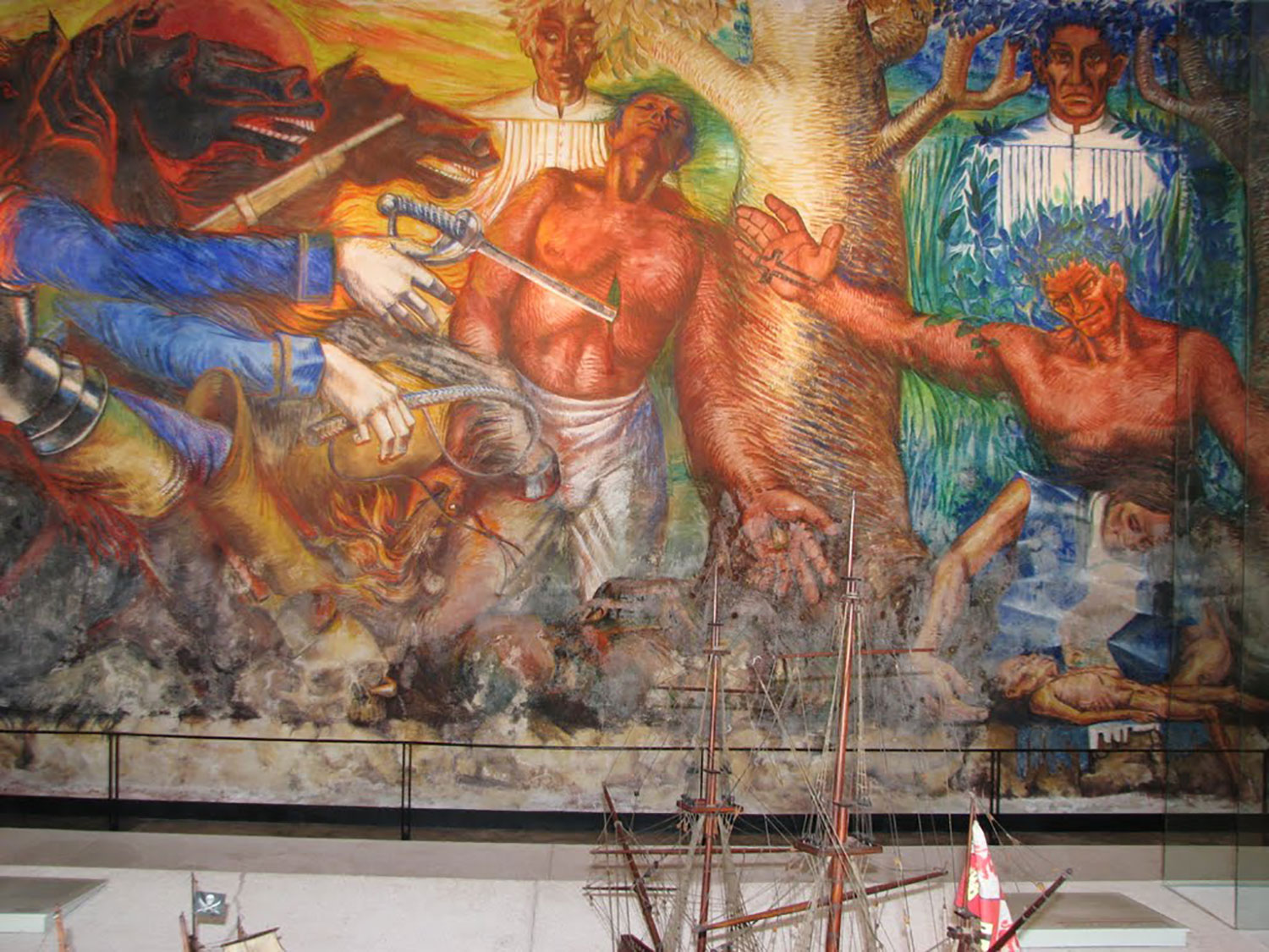 Elio Carmichael's mural of the Caste War at the nearby Bacalar fortress of San Felipe.