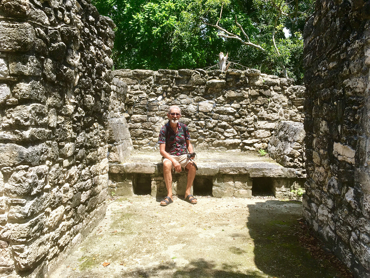 My husband Rhod sitting on a bed, which would have had a mattress filled with strong fibre from the ceiba (kapok) tree.