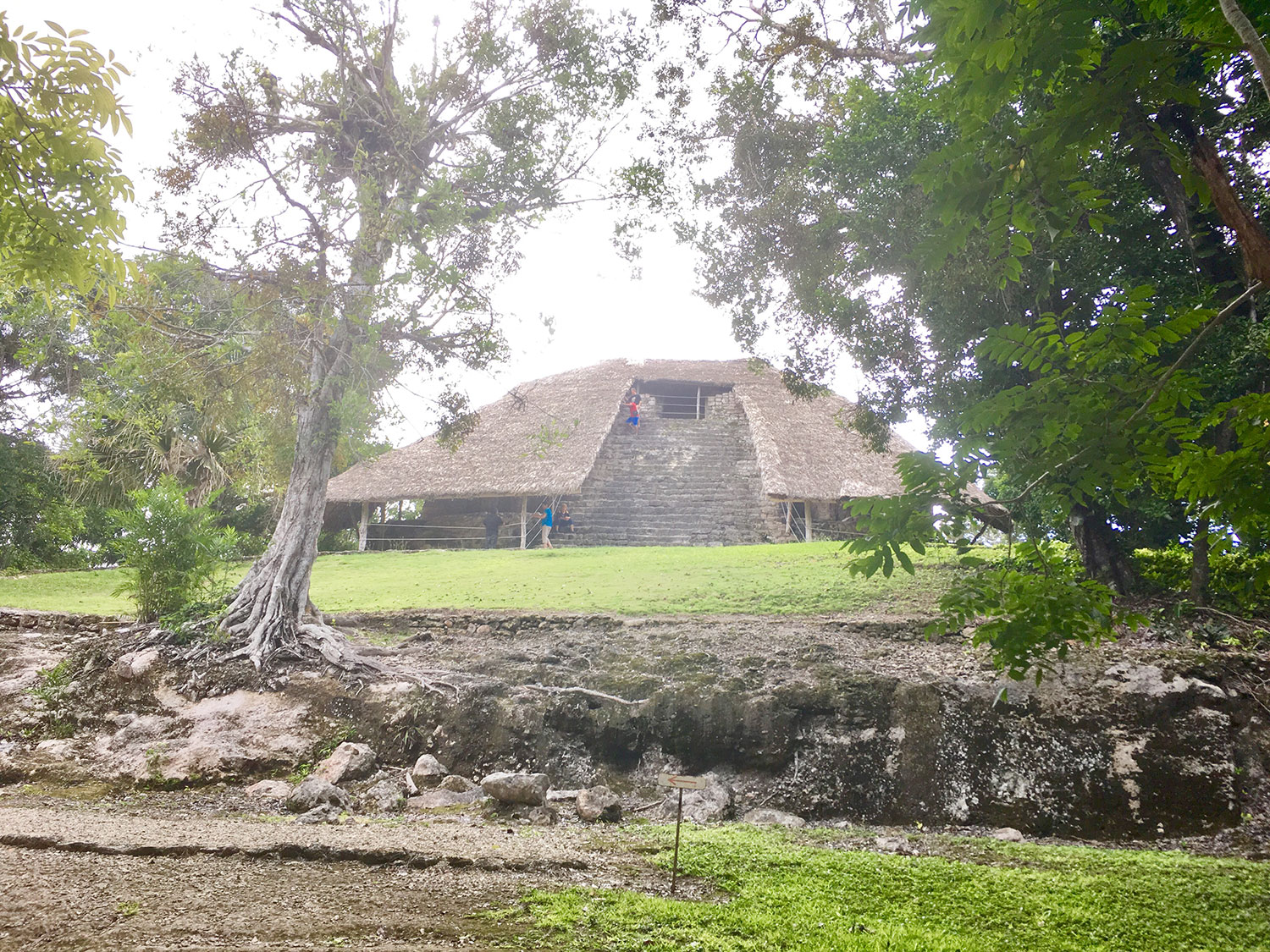 The Temple of Masks, with a thatch roof on each side of the stairway.