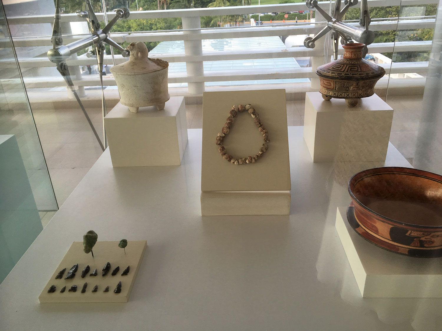 Jewellery and ceramic pots, now at the Mayan Museum in Cancún.