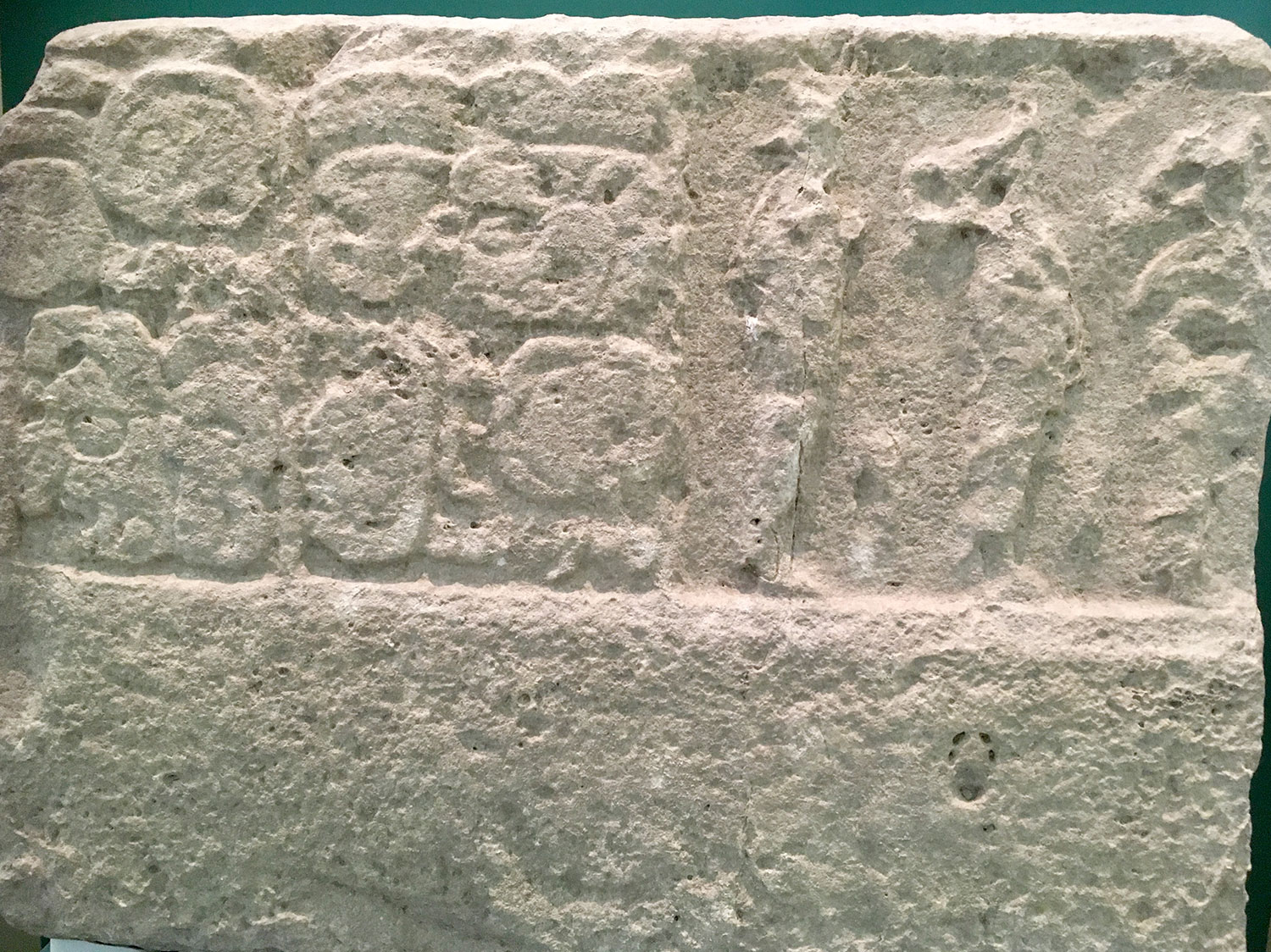 Monument 16: A panel with 16 people, the Mayan Museum in Cancún.