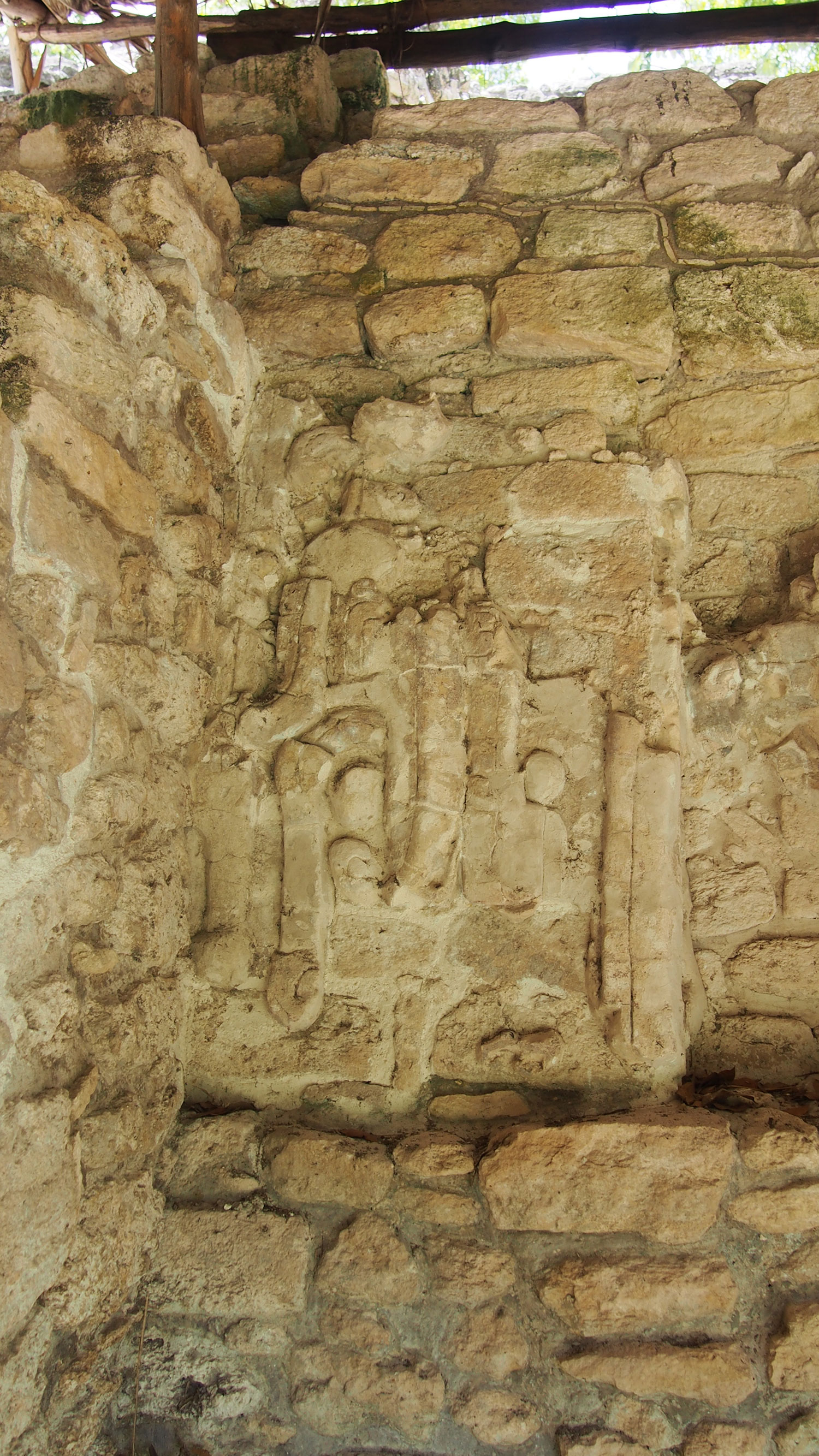 The masks on the Temple of the Captives. The local rulers?