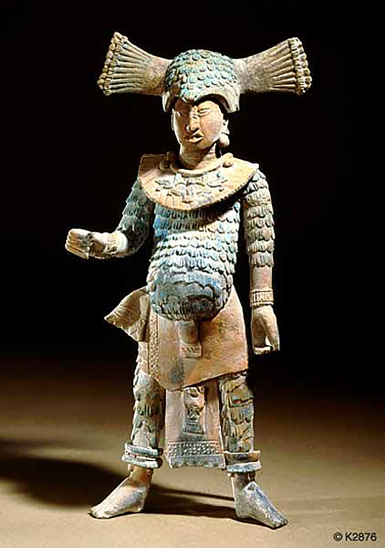 Warrior in feather costume, sculpture from Jaina island. Photo by Justin Kerr. Source:  pinterest.com.mx .