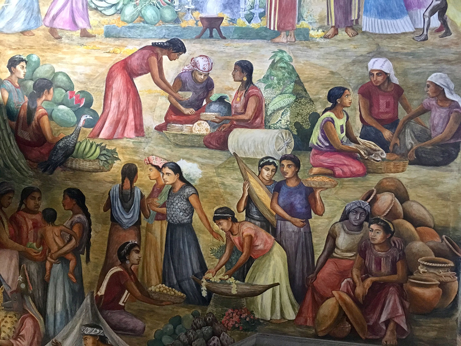 I took this photo of the mural at the Oaxaca Government Palace. It shows Zapotec women trading food at the market.