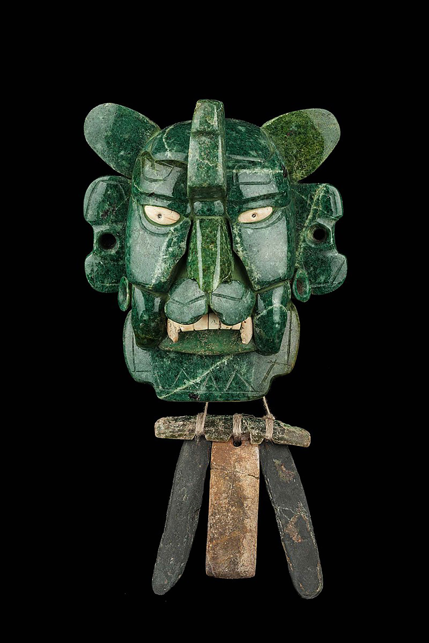 A jade mask of a Bat god from a tomb in Monte Albán:  en.wikipedia.org .