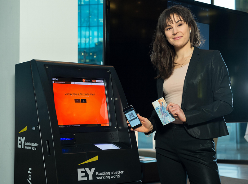 Isabella demonstrating the EY Bitcoin ATM in Zurich