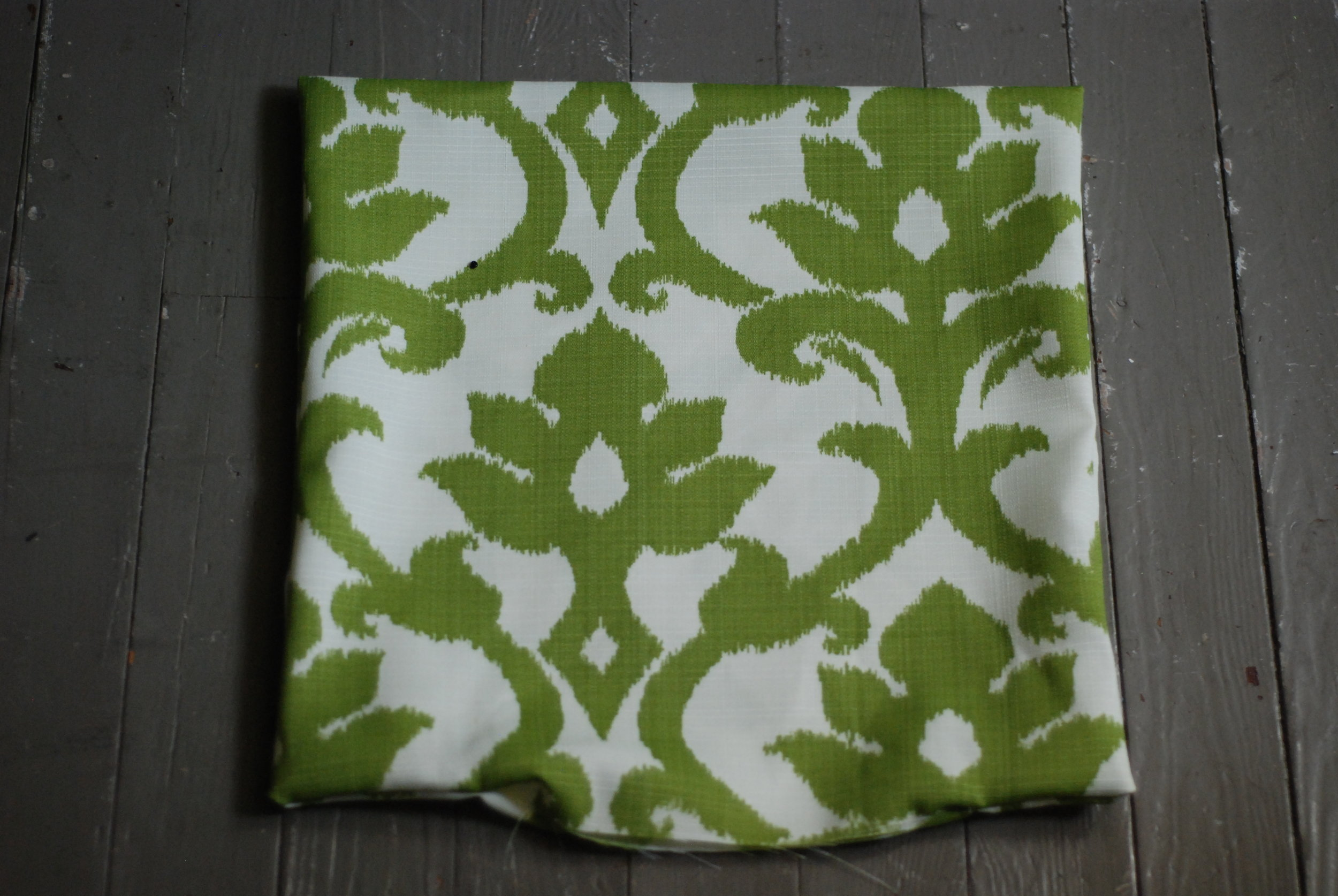 Turn pillow inside out. You can either stuff the pillow or buy a pillow frame from a local fabric store. Once you've stuffed your pillow, hand sew the opening.