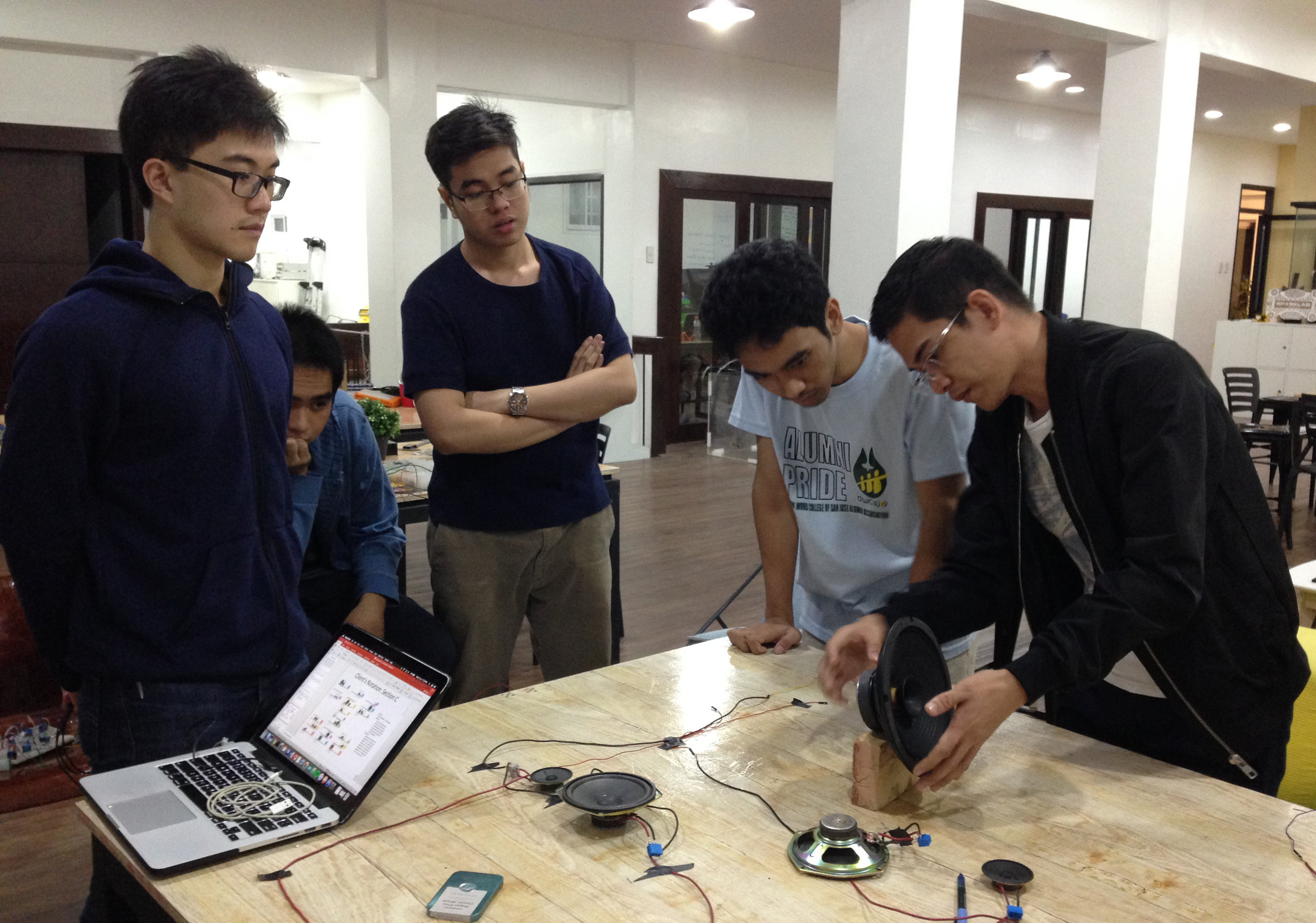 SPARKLAB engineers with Ed Lacson (art director).JPG