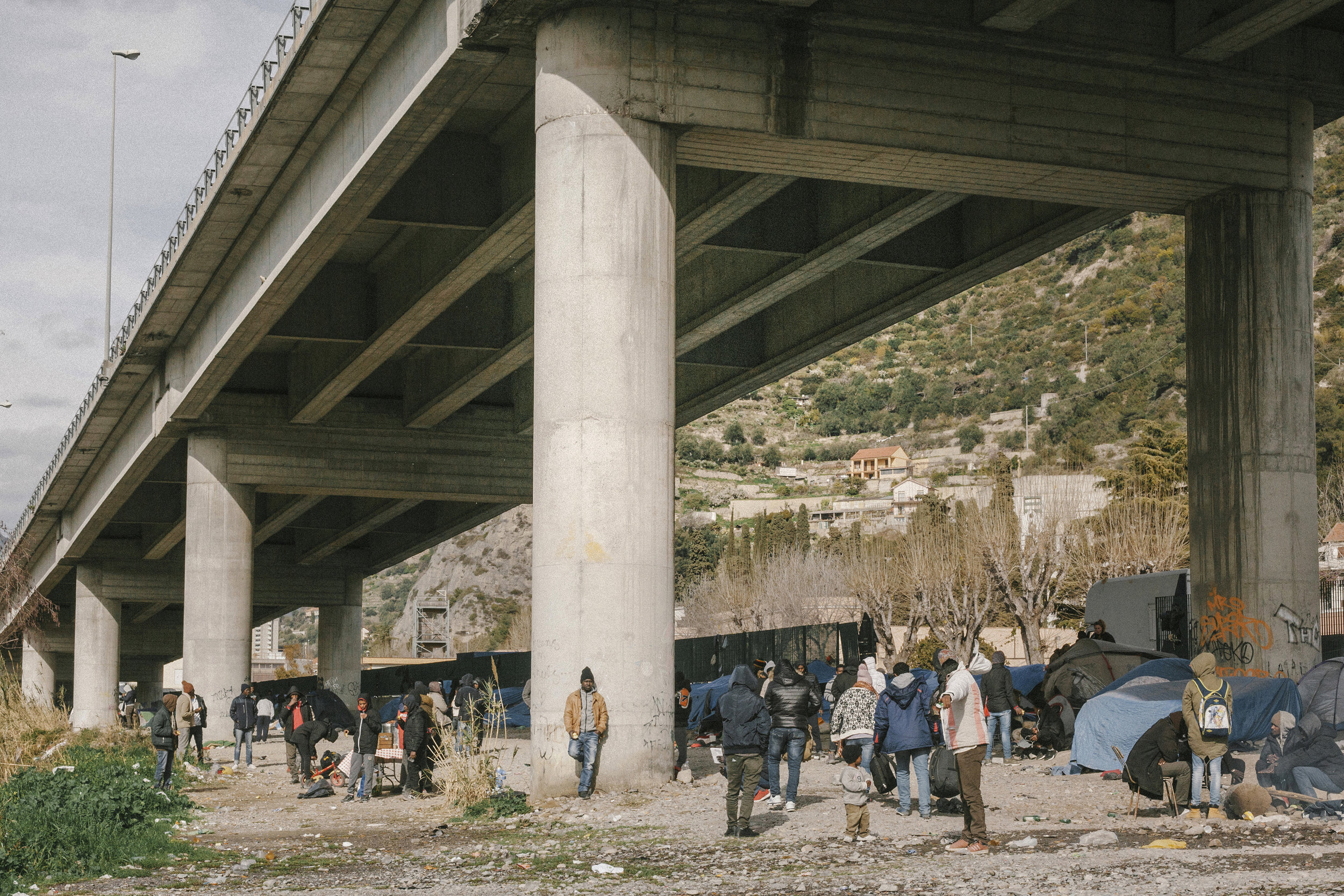 Asylum seekers camped out beneath one of the bridges in Ventimiglia that crosses the Roya River, which runs from the French Alps to the Mediterranean coast.  Photograph: Tjaša Kalkan for Point.51
