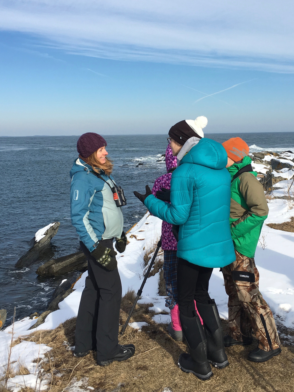 Anna, Ian, and Lena conversing about eider ID and all sorts of other birdy topics.  Photo by Robyn Ostrander
