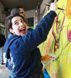 Erin painting cnj mural.jpg
