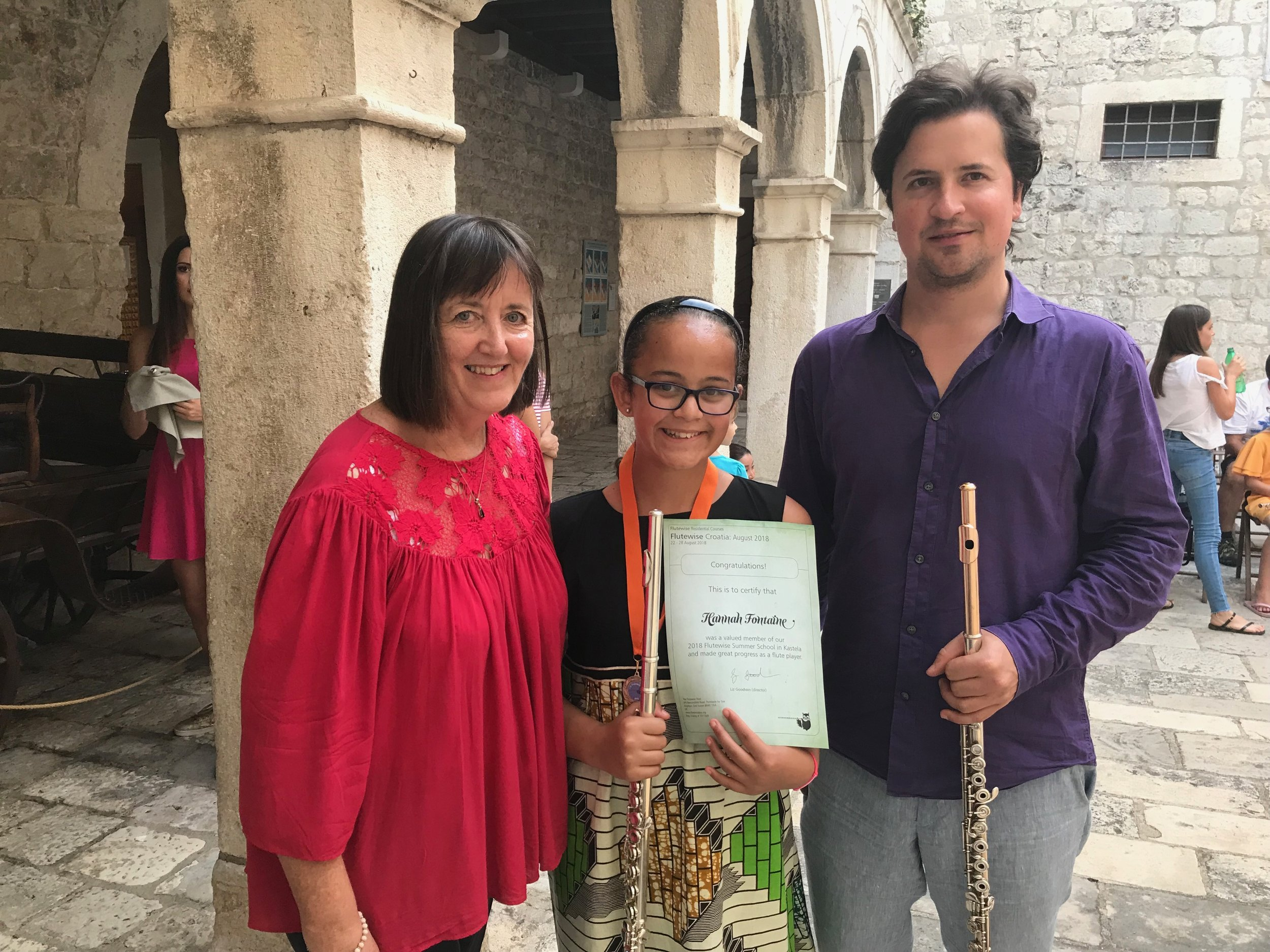 Hannah receiving her certificate with Liz and Marko Zupan