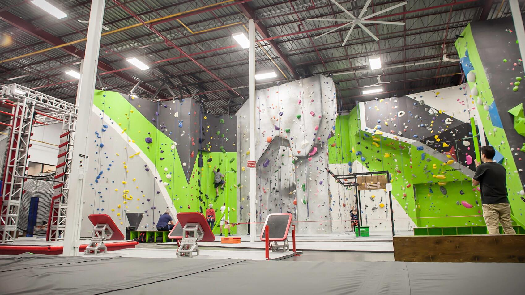 The ninja course co-existing with the climbing walls at Aspire Climbing.