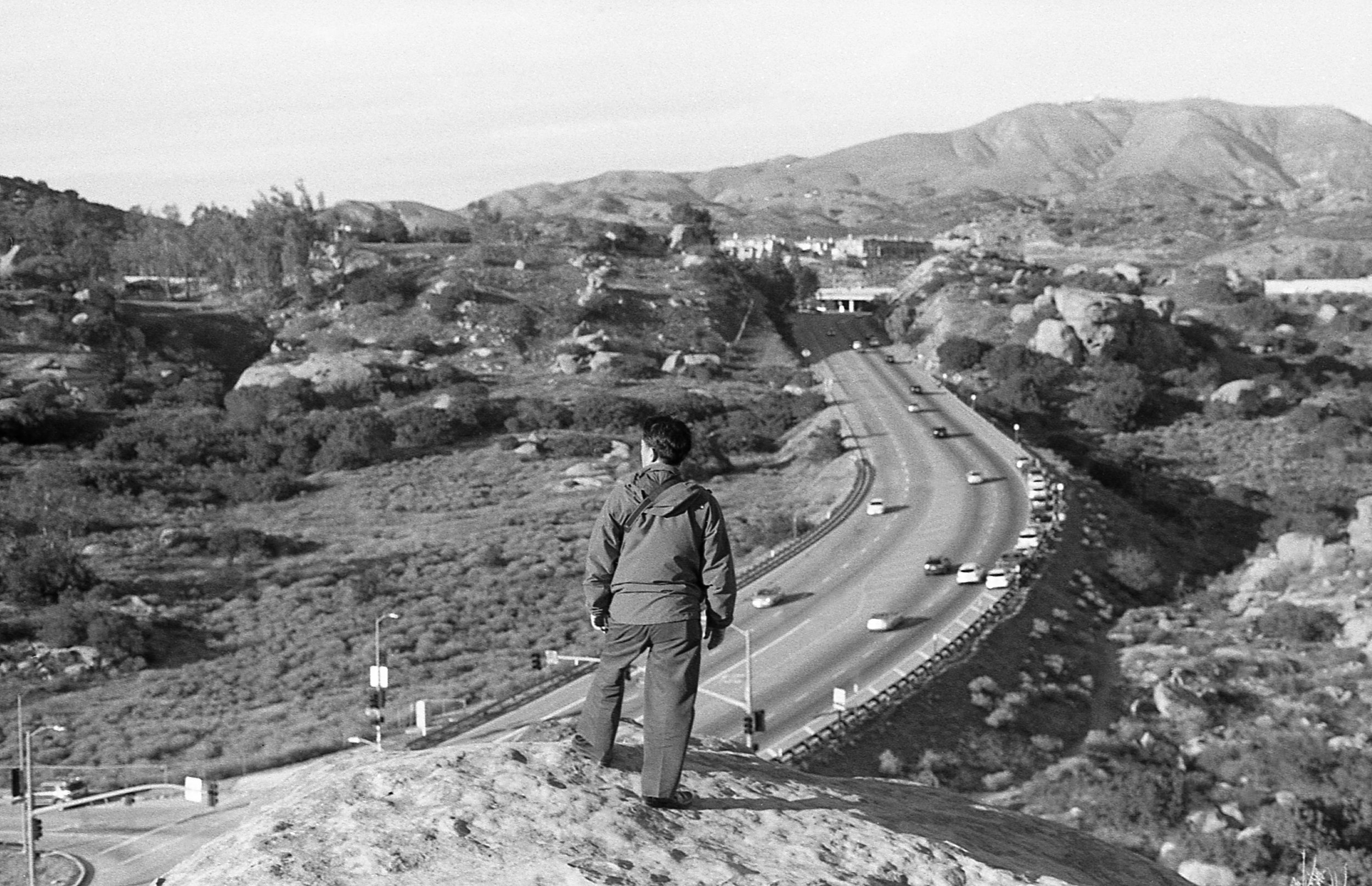 John's father standing on a promontory over Los Angeles.