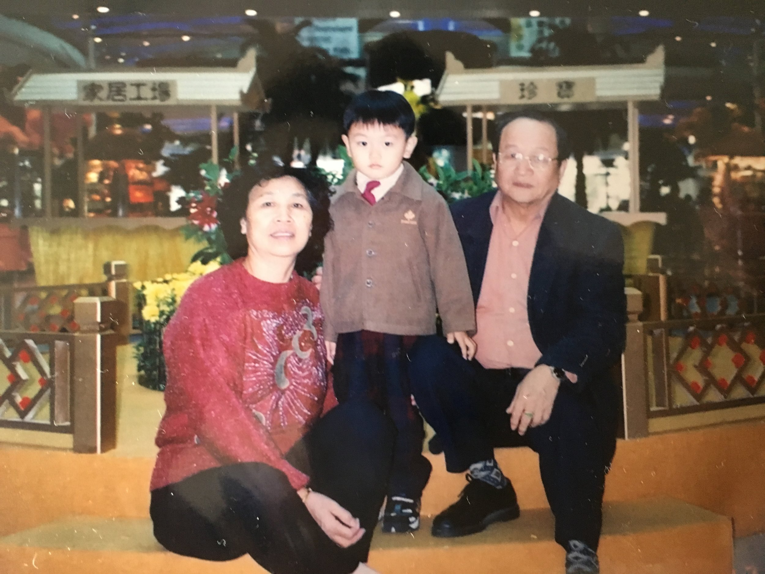 Rocky with his grandparents in Hong Kong, ca. 2002.