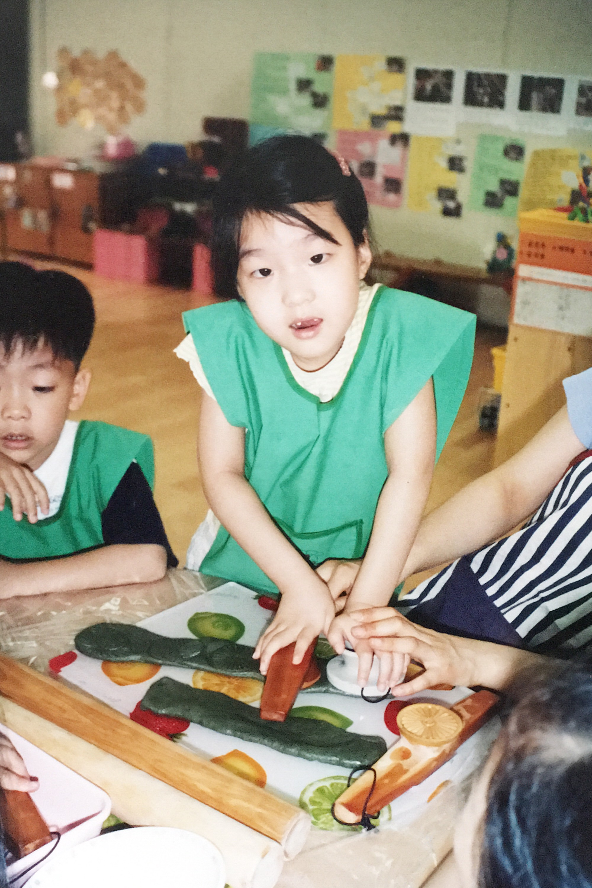 Jiyoung making rice cakes in kindergarten.